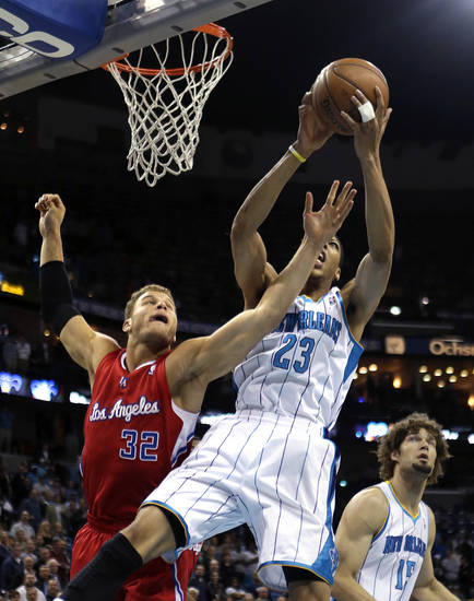 New Orleans Hornets forward Anthony Davis (23) battles for a rebound with Los Angeles Clippers forward Blake Griffin (32) in the first half of an NBA basketball game in New Orleans, Wednesday, March 27, 2013. (AP Photo/Gerald Herbert)