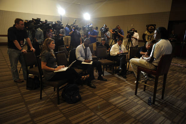 Baylor quarterback Robert Griffin III answers questions during Big 12 Media Days, Monday, July 25, 2011, in Dallas. (AP Photo/Matt Strasen) ORG XMIT: TXMS101