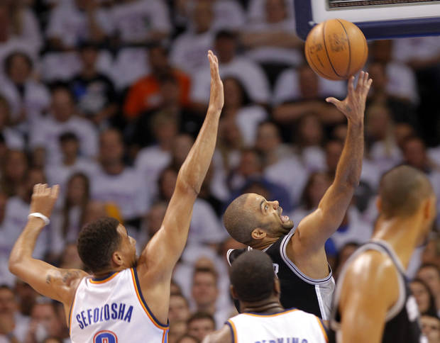 San Antonio's Tony Parker (9) drives past Oklahoma City's Thabo Sefolosha (2) during Game 6 of the Western Conference Finals between the Oklahoma City Thunder and the San Antonio Spurs in the NBA playoffs at the Chesapeake Energy Arena in Oklahoma City, Wednesday, June 6, 2012. Photo by Chris Landsberger, The Oklahoman