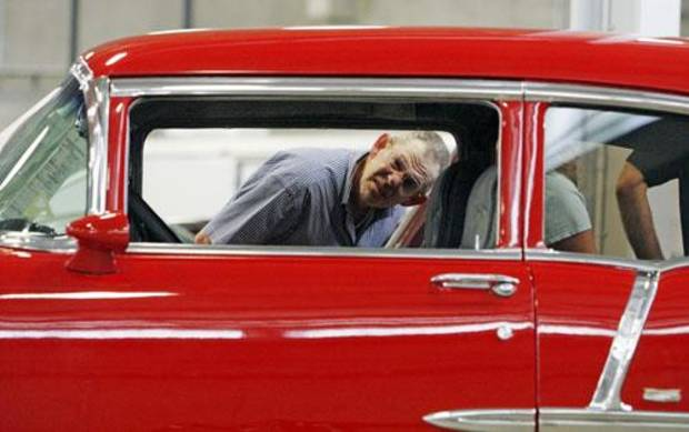 Jack Evans looks at the interior of a 1955 Chevrolet Bel Air before Santiago Auctions Oklahoma City Summer Classic car auction at the Oklahoma State Fairgrounds in Oklahoma City, Friday, July 18, 2008. BY NATE BILLINGS, THE OKLAHOMAN