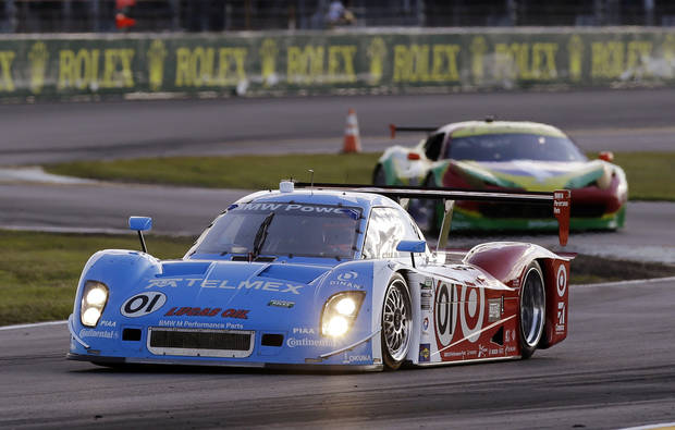 Scott Pruett drives the Ganassi Racing BMW Riley (01) during the early hours of the Grand-Am Series Rolex 24 hour auto race at Daytona International Speedway, Saturday, Jan. 26, 2013, in Daytona Beach, Fla. (AP Photo/John Raoux)