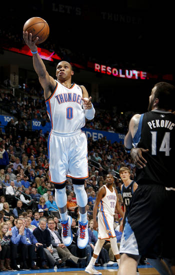 Oklahoma City's Russell Westbrook (0) goes to the basket beside Minnesota's Nikola Pekovic (14) during an NBA basketball game between the Oklahoma City Thunder and the Minnesota Timberwolves at Chesapeake Energy Arena in Oklahoma City, Wednesday, Jan. 9, 2013.  Oklahoma City won 106-84. Photo by Bryan Terry, The Oklahoman