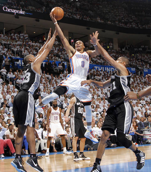 Oklahoma City's Russell Westbrook drives past San Antonio's Boris Diaw and Tim Duncan (21) during Game 6 of the Western Conference Finals between the Oklahoma City Thunder and the San Antonio Spurs in the NBA playoffs at the Chesapeake Energy Arena in Oklahoma City, Wednesday, June 6, 2012. Photo by Chris Landsberger, The Oklahoman