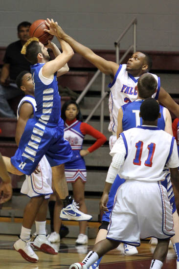 Millwood's Emmanuel Cole blocks the shot of Haskell's Dalton Cefalone during the Class 3A boys basketball game between Millwood and Haskell at Southern Nazarene University in Bethany Thursday, March 8th, 2012. PHOTO BY HUGH SCOTT, FOR THE OKLAHOMAN