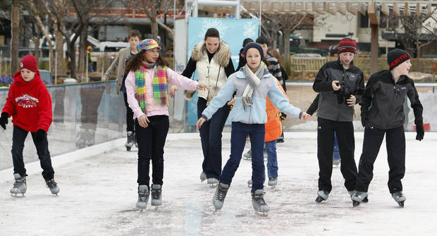 Ice skaters on the Devon ice rink at the Myriad Gardens are shown. Photo by Paul B. Southerland, The Oklahoman Archives