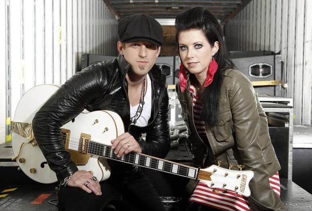 In this Oct. 27, 2011 photo, musicians Keifer Thompson, left, and Shawna Thompson, of the group Thompson Square, pose for a portrait in Los Angeles. The husband-wife team have been on tour with Jason Aldean, are headed out with Lady Antebellum, and have received a slew of award nominations, including in the competitive new artist of the year category at next week's Country Music Association Awards. (AP Photo/Matt Sayles) ORG XMIT: NYET931