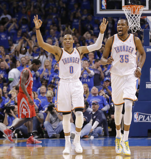 Oklahoma City�s Russell Westbrook and Kevin Durant react Wednesday night after a 3-pointer by Kevin Martin during Game 2 in the first round of the NBA Playoffs between the Thunder and the Houston Rockets at Chesapeake Energy Arena in Oklahoma City. Photo by Chris Landsberger, The Oklahoman