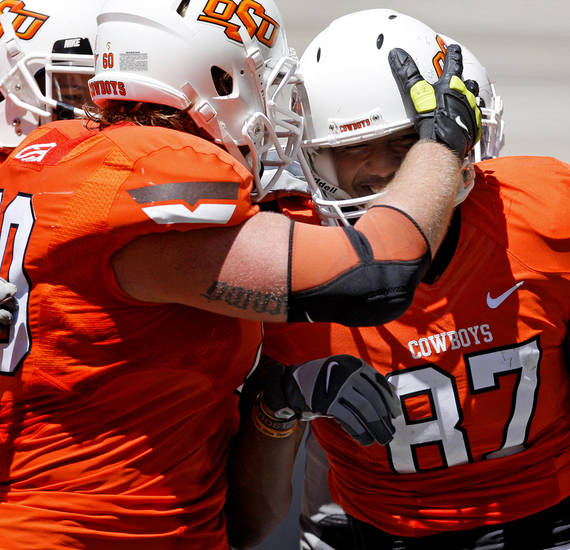 OSU's J.W. Walsh scrambles during Oklahoma State's spring football game at Boone Pickens Stadium in Stillwater, Okla., Saturday, April 21, 2012. Photo by Bryan Terry, The Oklahoman