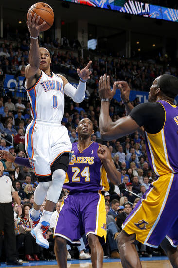 Oklahoma City's Russell Westbrook (0) goes past Los Angeles' Kobe Bryant (24) and Dwight Howard (12) during an NBA basketball game between the Oklahoma City Thunder and the Los Angeles Lakers at Chesapeake Energy Arena in Oklahoma City, Tuesday, March. 5, 2013. Photo by Bryan Terry, The Oklahoman
