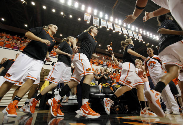 The OSU Cowgirls take the floor before the Women's NIT championship college basketball game between Oklahoma State University and James Madison at Gallagher-Iba Arena in Stillwater, Okla., Saturday, March 31, 2012. Photo by Nate Billings, The Oklahoman