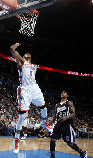 Oklahoma City's Russell Westbrook (0) shoots a lay up in front of Sacramento's Isaiah Thomas (22) during the NBA basketball game between the Oklahoma City Thunder and the Sacramento Kings at Chesapeake Energy Arena in Oklahoma City, Tuesday, April 24, 2012. Photo by Sarah Phipps, The Oklahoman.