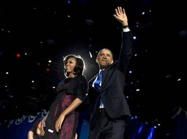 President Barack Obama and first lady Michelle Obama celebrate on stage at the election night party at McCormick Place, Wednesday, Nov. 7, 2012, in Chicago, to proclaim victory in the presidential election. (AP Photo/Carolyn Kaster)
