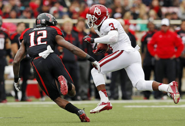 Oklahoma's Sterling Shepard (3) runs after a catch against Texas Tech's D.J. Johnson (12) during a college football game between the University of Oklahoma (OU) and Texas Tech University at Jones AT&T Stadium in Lubbock, Texas, Saturday, Oct. 6, 2012. OU won, 41-20. Photo by Nate Billings, The Oklahoman
