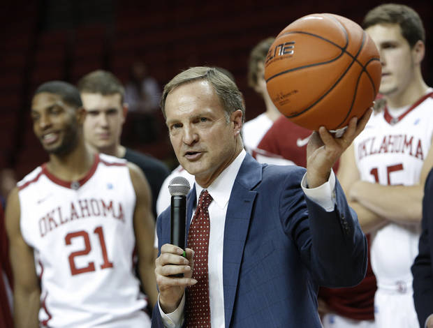 Oklahoma Head Coach Lon Kruger holds up the game ball after his 500th career win during a men's college basketball game between the University of Oklahoma and Northwestern Louisiana State University at the Lloyd Noble Center in Norman, Okla., Friday, Nov. 30, 2012.  Photo by Garett Fisbeck, The Oklahoman