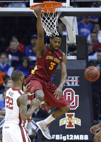 Iowa State's Melvin Ejim (3) dunks over Oklahoma's Amath M'Baye (22) during the Phillips 66 Big 12 Men's basketball championship tournament game between the University of Oklahoma and Iowa State at the Sprint Center in Kansas City, Thursday, March 14, 2013. Photo by Sarah Phipps, The Oklahoman