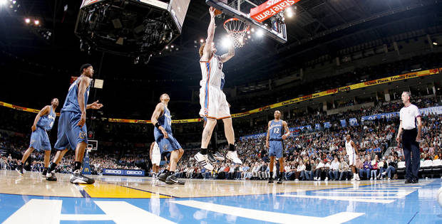 Oklahoma City's Robert Swift scores during the NBA basketball game between the Oklahoma City Thunder and the Washington Wizards at the Ford Center in Oklahoma City, Wed., March 4, 2009. PHOTO BY BRYAN TERRY, THE OKLAHOMAN