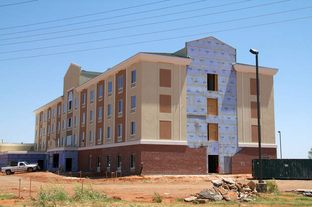 A new Holiday Inn hotel is under construction in Elk City. The booming oil business has filled the western Oklahoma town's hotels to capacity. <strong></strong>