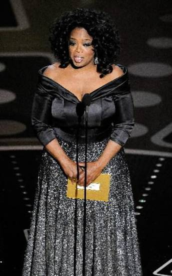 Oprah Winfrey presents an award.