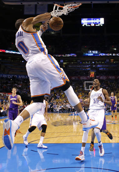 Oklahoma City's' Kevin Durant (35) celebrates the dunk of  Russell Westbrook (0) during the NBA game between the Oklahoma City Thunder and the Phoenix Suns at theChesapeake Energy Arena, Friday, Feb. 8, 2013.Photo by Sarah Phipps, The Oklahoman