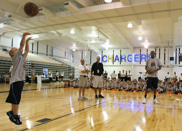 Kevin Durant goes head-to-head in a shootout with Jake Cochnauer, 8 of Minnesota, during the second day of the Kevin Durant basketball camp at Heritage Hall in Oklahoma City, Thursday, June 30, 2011.  Photo by Garett Fisbeck, The Oklahoman