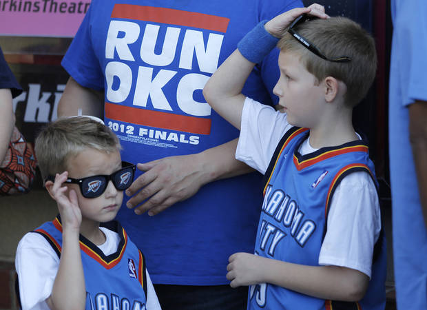 Mason McGregor, 7, and brother Ian, 9, of Edmond, Okla., wait in line for the red carpet premiere of Thunderstruck at Harkins Bricktown Theatre in Oklahoma City, Sunday, Aug. 19, 2012.  Photo by Garett Fisbeck, For The Oklahoman
