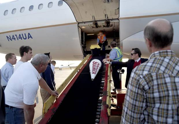Baggage claim on the Oklahoma City airport tarmac. Photo by Sarah Phipps, The Oklahoman