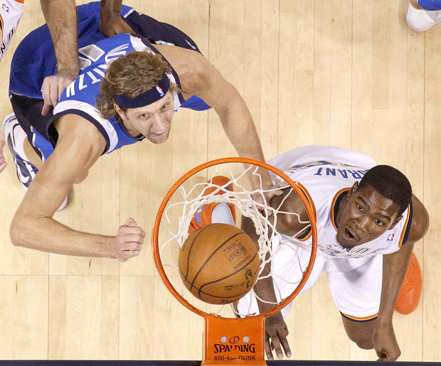 Oklahoma City's Kevin Durant watches the ball go in the basket beside Dirk Nowitzki of Dallas during the NBA basketball game between the Oklahoma City Thunder and the Dallas Mavericks at the Ford Center in Oklahoma City on Wednesday, December 16, 2009. Photo by Bryan Terry, The Oklahoman ORG XMIT: KOD