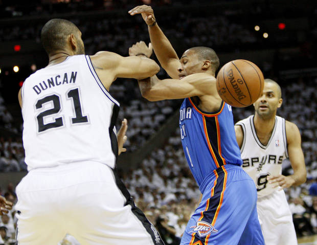 Oklahoma City's Russell Westbrook (0) loses the ball between San Antonio's Tim Duncan (21) and Tony Parker (9) during Game 5 of the Western Conference Finals between the Oklahoma City Thunder and the San Antonio Spurs in the NBA basketball playoffs at the AT&T Center in San Antonio, Monday, June 4, 2012. Photo by Nate Billings, The Oklahoman