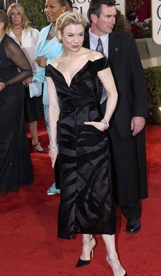 "Renee Zellweger, nominated for best performance by an actress in a motion picture-musical or comedy for her work in ""Chicago,"" arrives for the 60th Annual Golden Globe Awards, in Beverly Hills, Calif., Sunday, Jan. 19, 2003. (AP Photo/Mark J. Terrill)"