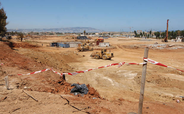 In this July 18, 2012 photo, a red-and-white tape is used around the building site of the Great Mosque of Algeria in Algiers. China is now pushing into construction and engineering, where U.S. and European companies have long dominated. In Algeria, Chinese state-owned companies pushed aside established French and German rivals to  win contracts to build a $12 billion cross-country highway and the $1.3 billion mosque. The mosque is set to be completed by 2015. (AP Photo/Sidali Djarboub)