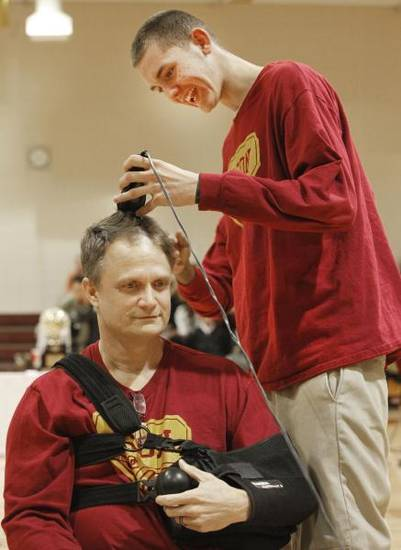 HIGH SCHOOL BASKETBALL / STATE CHAMPIONSHIP / CELEBRATE / CELEBRATION: Coach Scott Raper gets his head shaved by freshman Austin Garner during an assembly celebrating the Centennial boys state basketball championship in Oklahoma City , March 25 , 2011. Photo by Steve Gooch, The Oklahoman <strong>Steve Gooch</strong>