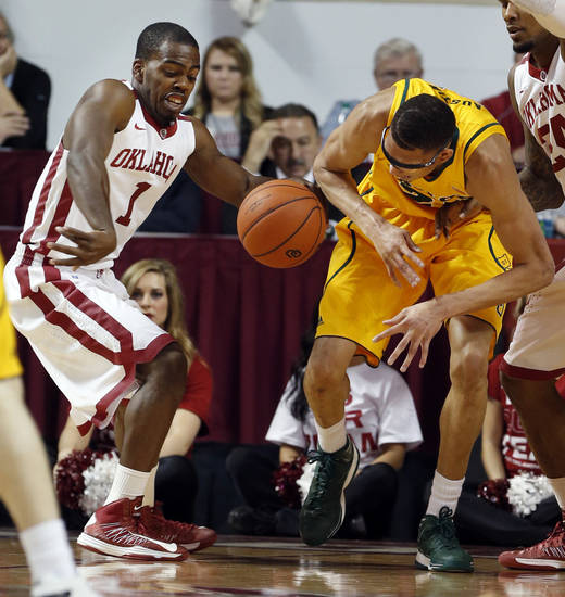 Oklahoma Sooner's Sam Grooms (1) knocks the ball from the grasp of Baylor Bear's Isaiah Austin (21) as the University of Oklahoma Sooners (OU) men play the Baylor University Bears (BU) in NCAA, college basketball at The Lloyd Noble Center on Saturday, Feb. 23, 2013  in Norman, Okla. Photo by Steve Sisney, The Oklahoman
