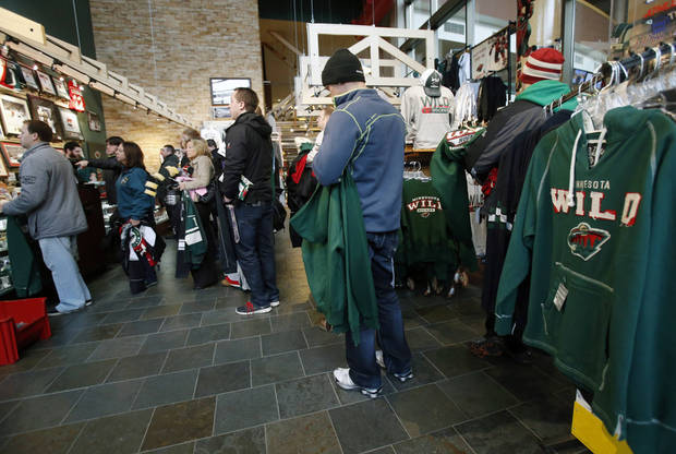 Minnesota Wild NHL hockey fans took advantage of a one-day, 50 percent off sale of Wild-related merchandise at the team's hockey lodge store Wednesday, Jan. 16, 2013, in St. Paul, Minn. The Wild play their season home opener Saturday against the Colorado Avalanche. (AP Photo/Jim Mone)
