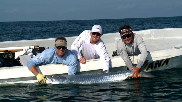 Former OSU and current Cleveland Browns quarterback Brandon Weeden caught this trophy tarpon near Cancun, Mexico while filming a fishing trip for Gridiron Outdoors on the Outdoor Channel. The fish, estimated at 130 pounds, was released by Weeden. The show airs Friday and Saturday.