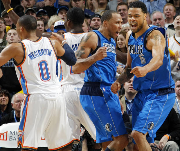 Tyson Chandler (6) and Shawn Marion (0) of Dallas react in front of Oklahoma City's Jeff Green (22) and Russell Westbrook (0) after a Dallas basket in the fourth quarter during the NBA basketball game between the Dallas Mavericks and the Oklahoma City Thunder at the Oklahoma City Arena in Oklahoma City, Monday, Dec. 27, 2010. Dallas won, 103-93. Photo by Nate Billings, The Oklahoman