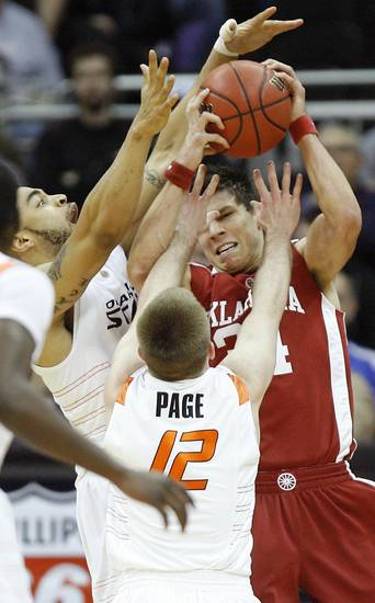 OU's Cade Davis is defended by OSU's Marshall Moses, left, and Keiton Page in the first half of the college basketball game during the men's Big 12 Championship tournament at the Sprint Center on Wednesday, March 10, 2010, in Kansas City, Mo. Photo by Bryan Terry, The Oklahoman