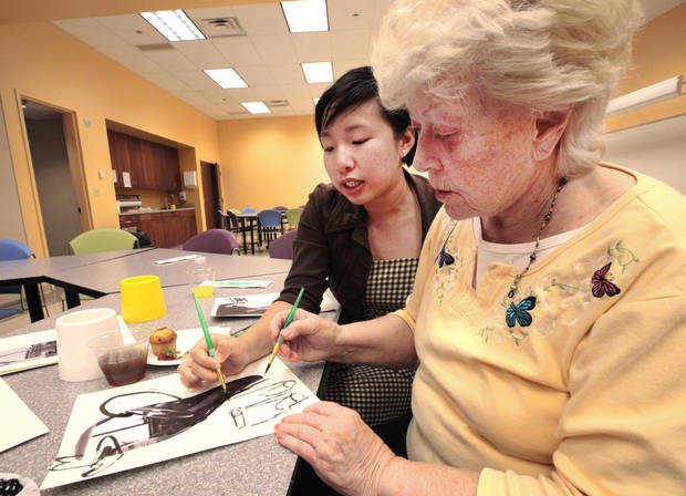 Education intern Jessica Lie works with dementia patient Peggy Morrison on an art project at the Oklahoma City Museum of art. Photo by David McDaniel, The Oklahoman <strong>David McDaniel - The Oklahoman</strong>