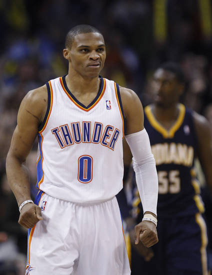 Oklahoma City Thunder guard Russell Westbrook (0) react after hitting a shot against the Indiana Pacers in the fourth quarter of an NBA basketball game in Oklahoma City, Sunday, Dec. 9, 2012. Oklahoma City won 104-93. (AP Photo/Sue Ogrocki) ORG XMIT: OKSO108