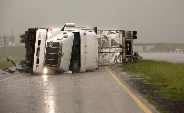 Overturned trucks block a frontage road off I-40 just east of 81 in El Reno, Okla., after a tornado moved through the area on Friday, May 31, 2013. Photo by Jim Beckel, The Oklahoman