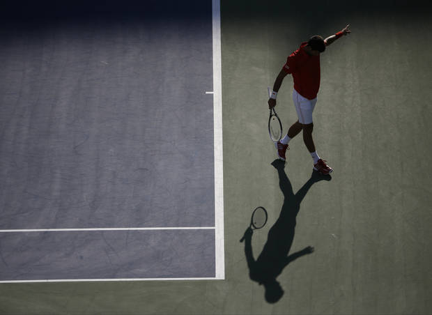 Novak Djokovic, of Serbia, reacts after a point against Marcel Granollers, of Spain, during the fourth round of the 2013 U.S. Open tennis tournament, Tuesday, Sept. 3, 2013, in New York. (AP Photo/Charles Krupa)