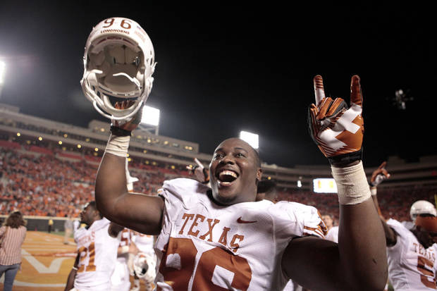 Texas&#039; Chris Whaley (96) celebrates the Longhorns&#039; win over Oklahoma State University (OSU) and the University of Texas (UT) at Boone Pickens Stadium in Stillwater, Okla., Saturday, Sept. 29, 2012. Texas on 41-36. Photo by Sarah Phipps, The Oklahoman