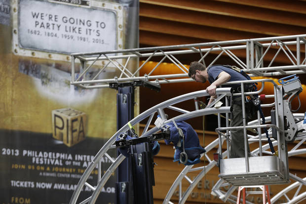 A workmen begin Preparations for the Philadelphia International Festival of the Arts 2013, at the Kimmel Center Tuesday, Feb. 19, 2013, in Philadelphia.  The citywide festival is scheduled to run from March 28 to April 27. (AP Photo/Matt Rourke)