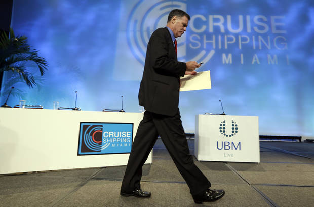 Gerry Cahill, president and CEO of Carnival Cruise Lines, walks off the stage following the State of the Industry session at the 29th annual Cruise Shipping Miami conference, Tuesday, March 12, 2013, in Miami Beach, Fla. Carnival Cruise Line�s highest priority is to look at �learnings and potential changes� that can be made after the Triumph stranding last month, said Cahill.  (AP Photo/Lynne Sladky)