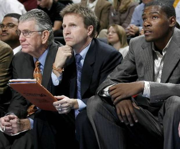 Scott Brooks, center, sits on the bench during the NBA basketball game between the Oklahoma City Thunder and the Orlando Magic at the Ford Center in Oklahoma City, Wednesday, Nov. 12, 2008. Brooks was named interim coach after P.J. Carlesimo was fired. BY BRYAN TERRY