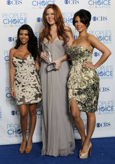 "From left, Kourtney Kardashian, Khloe Kardashian, and Kim Kardashian pose for a photo backstage with the award for favorite TV guilty pleasure for ""Keeping Up with the Kardashians"" at the People's Choice Awards on Wednesday, Jan. 5, 2011, in Los Angeles. (AP Photo/Matt Sayles) ORG XMIT: CASH187"