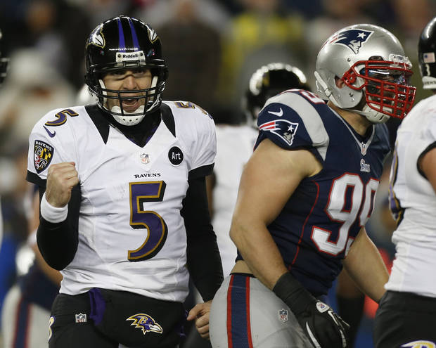 Baltimore Ravens quarterback Joe Flacco (5) reacts after throwing a five-yeard touchdown pass to Dennis Pitta during the second half of the NFL football AFC Championship football game against the New England Patriots in Foxborough, Mass., Sunday, Jan. 20, 2013. Right is New England Patriots defensive end Trevor Scott. (AP Photo/Charles Krupa) ORG XMIT: AFC156