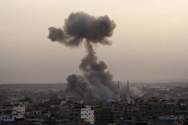 Smoke rises following an Israeli strike in Zeitun, on the outskirts of Gaza City, Saturday, Nov. 17, 2012. (AP Photo/Hatem Moussa)