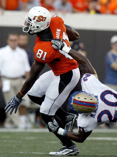 Oklahoma State wide receiver Justin Blackmon (81) is brought down by Tulsa's Marco Nelson (20) during the college football game between the University of Tulsa (TU) and Oklahoma State University (OSU) at Boone Pickens Stadium in Stillwater, Oklahoma, Saturday, September 18, 2010. Photo by Sarah Phipps, The Oklahoman