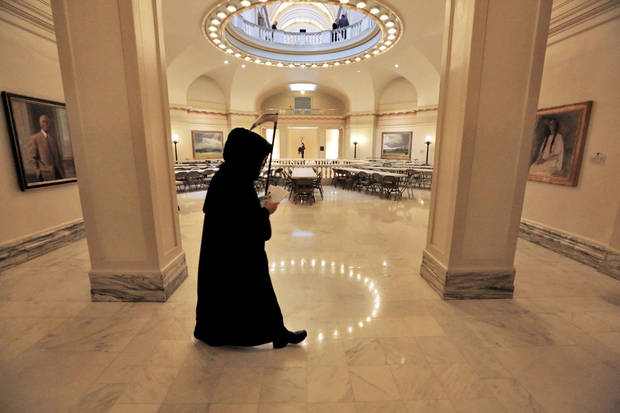 The �Grim Reaper� walks Tuesday in the rotunda of the state Capitol as part of Gov. Mary Fallin�s announcement for plans to put tobacco regulations aimed at reducing secondhand smoke to a vote of the people. Photo By Steve Gooch, The Oklahoman