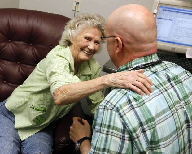 Faye Fullen of Wister, OK, hugs Dr. Dennis Carter at the beginning of an appointment at  Carter's office in Poteau on June 13. Fullen has known  Carter since he was in high school. Photo by Nate Billings, The Oklahoman <strong>NATE BILLINGS - NATE BILLINGS</strong>